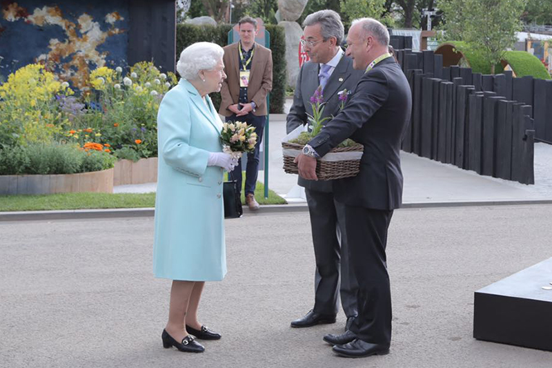 The Queen is presented an orchid